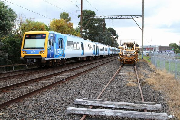 X'Trapolis 951M leads a down service past the works siding at Bell station