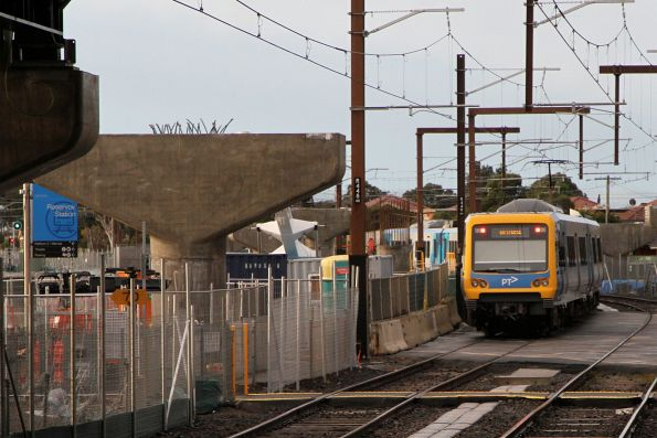 X'Trapolis crosses the closed level crossing at Reservoir on a down Mernda station
