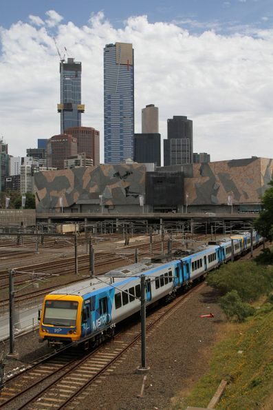 X'Trapolis 882M leads an up service into Flinders Street