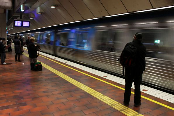 Metro liveried Comeng departs Melbourne Central