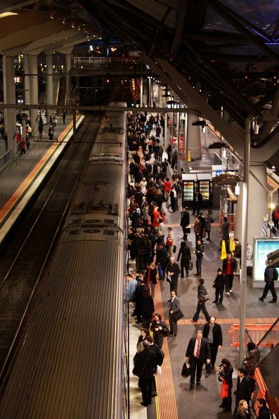 Southern Cross in peak, passengers board a train on platform 12