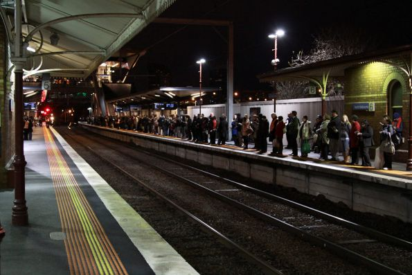 Passengers wait at North Melbourne platform 6