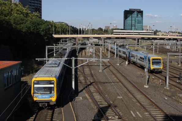 Pair of X'Trapolis trains duck under Federation Square on their way into Flinders Street