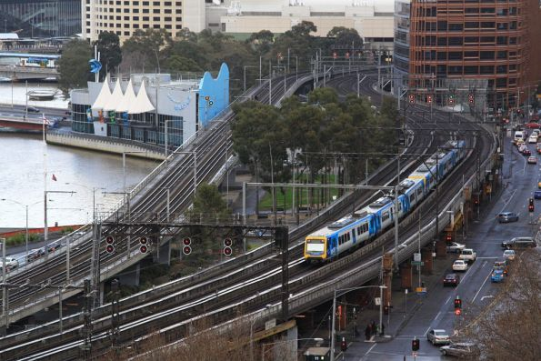 X'Trapolis train heads west over the Viaduct from Flinders Street Station