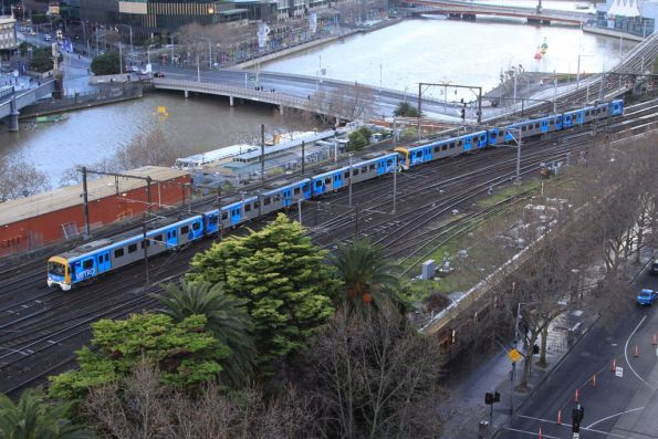 Siemens train arrives at Flinders Street Station from the Viaduct