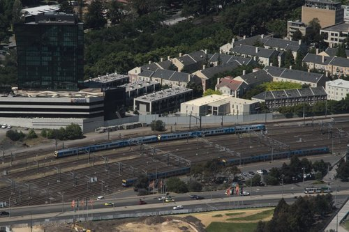 Comeng and X'Trapolis trains pass outside Richmond Junction
