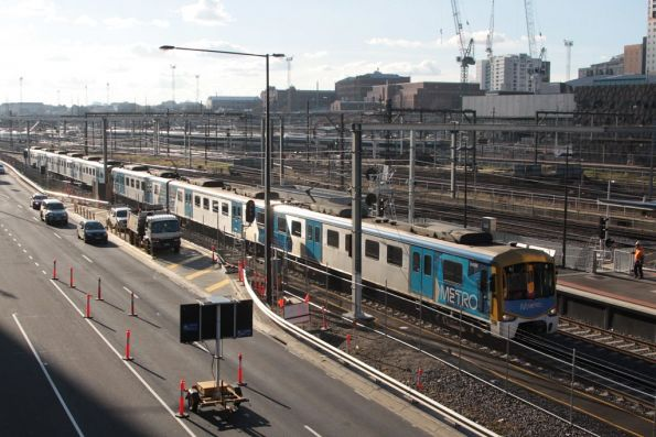 Siemens train passes Southern Cross Station on the up, on the single tracked Metro & Freight Bypass line
