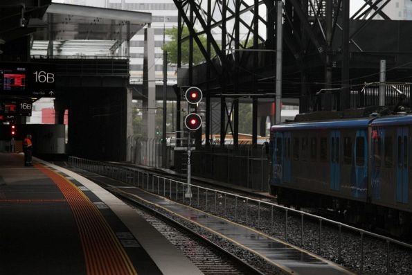 Siemens train on an empty cars run waits for the signal at Southern Cross towards Viaduct Junction