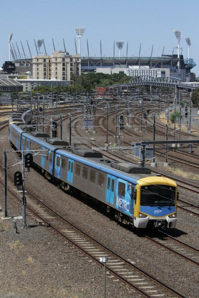 Siemens on an up Caulfield group service approaches Flinders Street Station