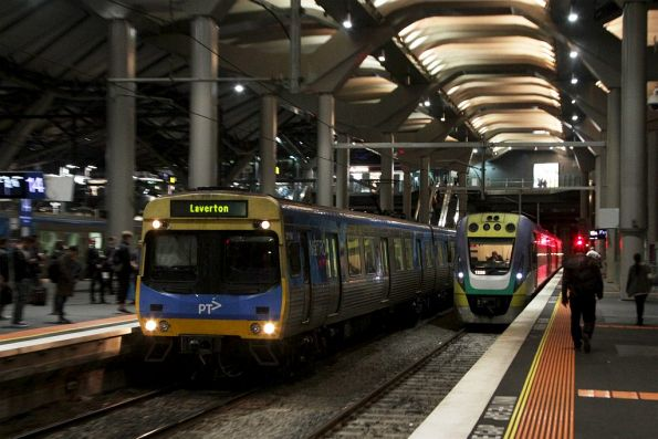 EDI Comeng arrives into platform 14 at Southern Cross, with a V/Line service in platform 15