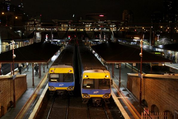 Comeng trains cross paths at North Melbourne station