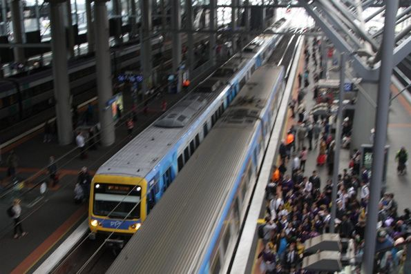 X'Trapolis train heads through Southern Cross platform 13 on an empty car move from Flemington Racecourse