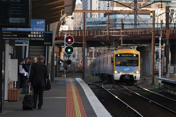 Siemens train emerges from the City Loop at North Melbourne with a down Watergardens service