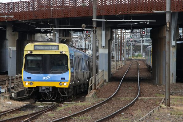 EDI Comeng emerges from the City Loop at North Melbourne with a down Watergardens service