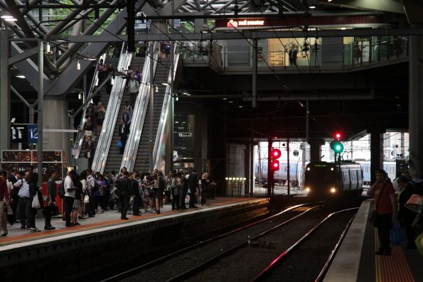 Comeng train holds short of platform 12, due to a red signal and congestion in the City Loop