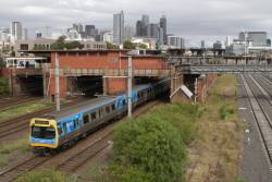 Comeng 526M trails an up service at North Melbourne station