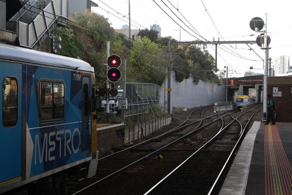 Citybound Comeng train sticks out of the City Loop portal at North Melbourne due to a track circuit failure, as a following train waits in the platform