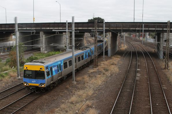 Alstom Comeng 651M leads an up Craigieburn service off the Essendon Flyover tracks at North Melbourne