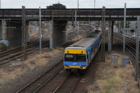 Alstom Comeng leads an up service into North Melbourne station