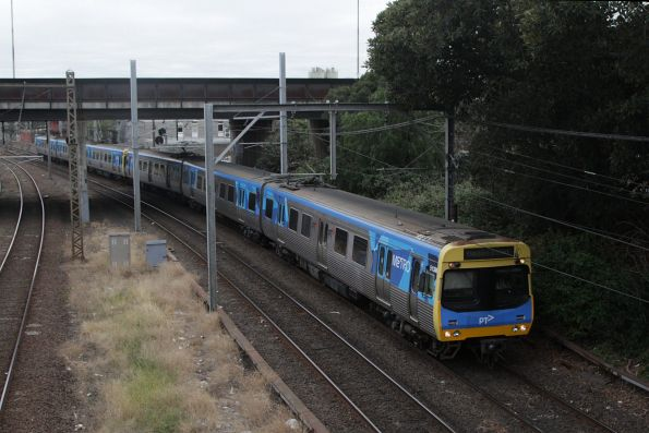 EDI Comeng 513M leads an up Upfield service at North Melbourne