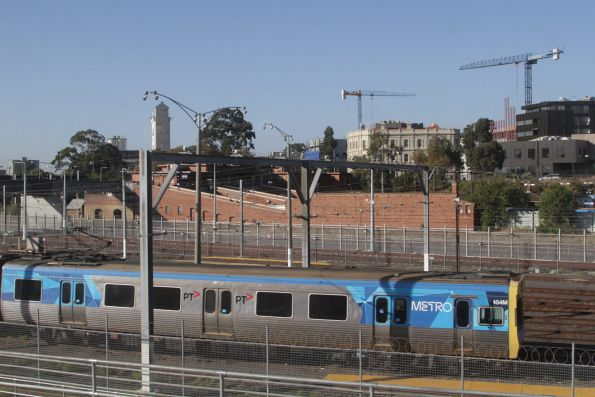 EDI Comeng 454M stabled at Melbourne Yard, as apartment blocks start to fill the North Melbourne skyline