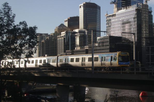 EDI Comeng leads a down service over the Flinders Street Viaduct