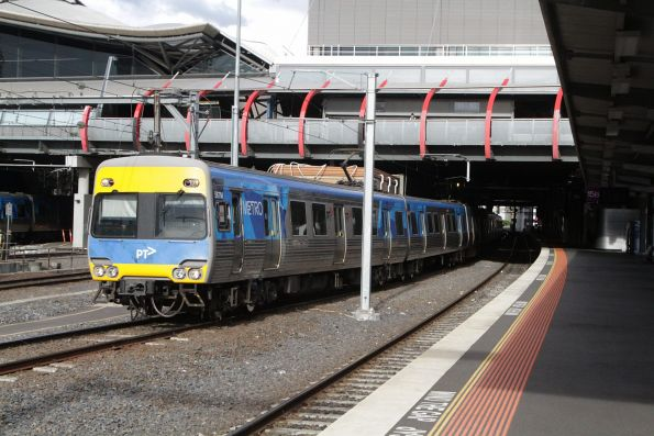 Comeng 567M departs Southern Cross Station on the down