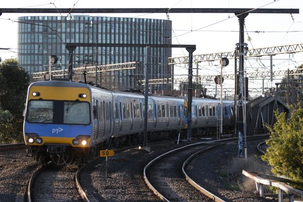 Alstom Comeng train approaches Richmond with a citybound Frankston line service