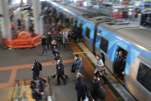 Passengers exit a train at Southern Cross platform 13