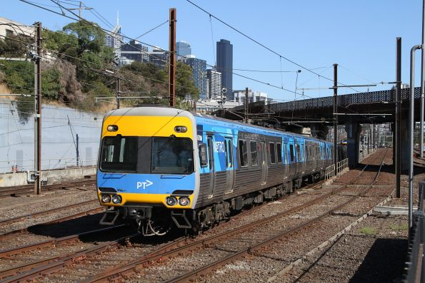 Comeng 678M on a down Sunbury service exits the City Loop at North Melbourne