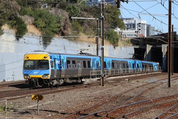 Comeng 648M exits the City Loop at North Melbourne
