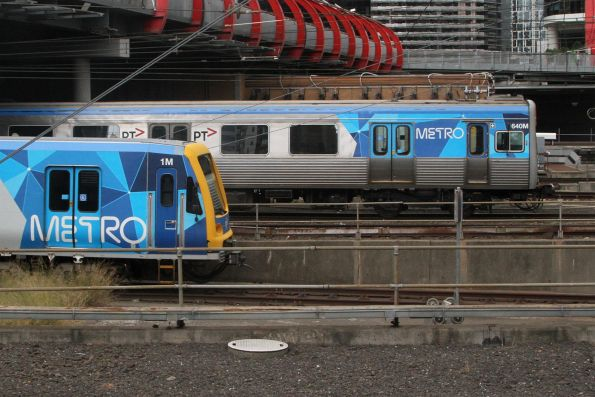 X'Trapolis 1M and Comeng 640M depart parallel from Southern Cross Station