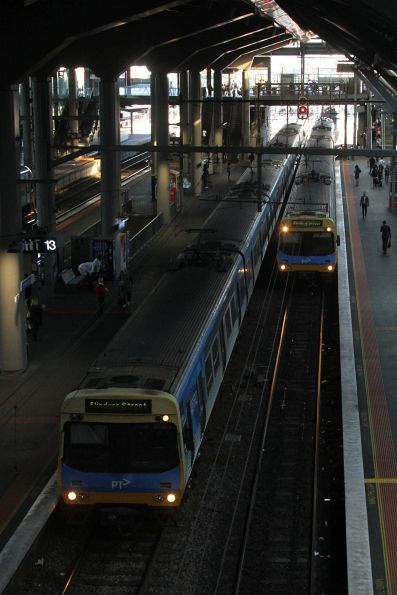 Pair of Comeng trains run parallel at Southern Cross