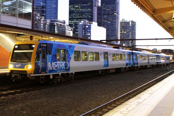 X'Trapolis 210M departs Flinders Street platform 4 with a 3-car empty car move