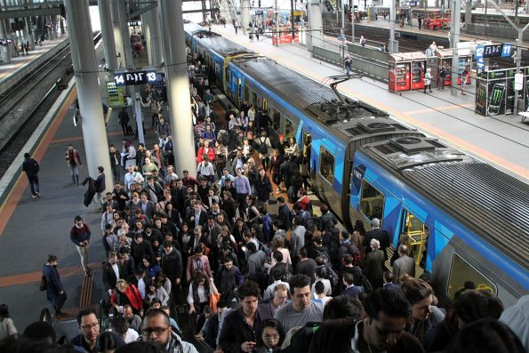 Crowd of passengers exit an up train at Southern Cross Station