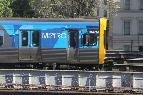 EDI Comeng 347M crosses the Flinders Street viaduct