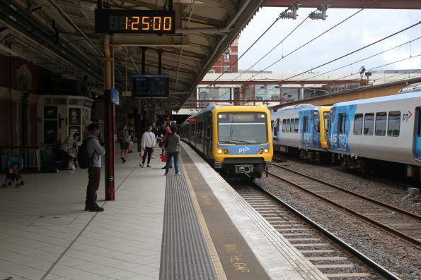 X'Trapolis train arrives into Flinders Street platform 1 with a down Mernda service
