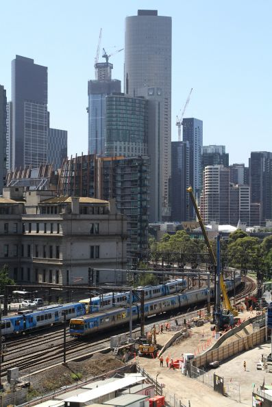 X'Trapolis and Comeng trains cross the Flinders Street Viaduct
