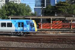 X'Trapolis 947M departs Flinders Street on the down
