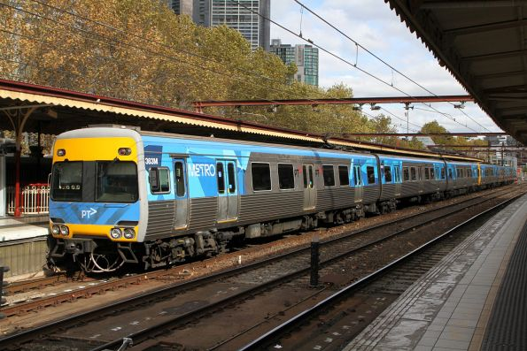 Connex livery starting to show beneath Alstom Comeng 363M at Flinders Street Station