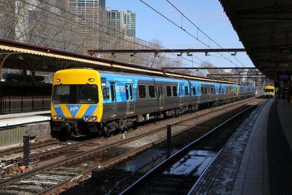 Life extension Alstom Comeng 585M and classmate arrive side by side into Flinders Street platforms 9 and 10