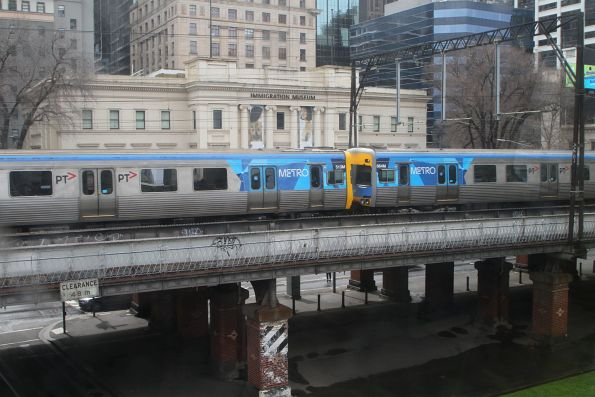 EDI Comeng 513M and Alstom Comeng 664M head east over the Flinders Street Viaduct