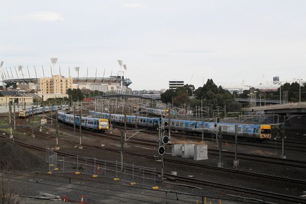 X'Trapolis and Comeng trains waiting outside Flinders Street Station