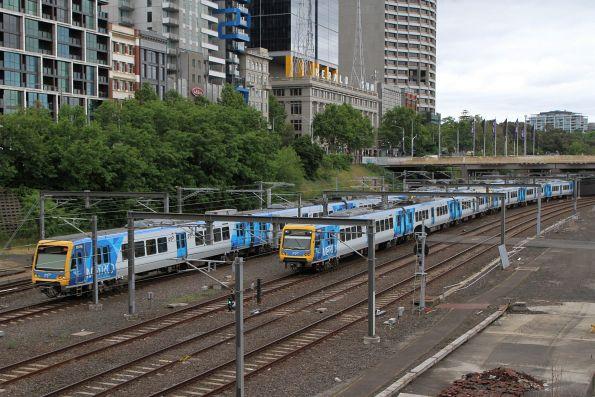 X'Trapolis 251M and 100M pass outside Flinders Street Station