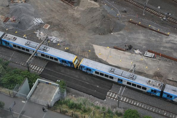 X'Trapolis 97M and 185M on an up Clifton Hill group service approaches Flinders Street