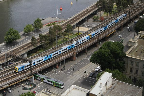 X'Trapolis 937M leads a down Burnley Group service over the Flinders Street Viaduct