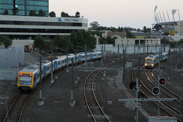 X'Trapolis 217M passes a 3-car set led by 75M outside Flinders Street