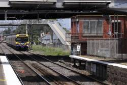Down EDI Comeng approaches the closed signal box at West Footscray