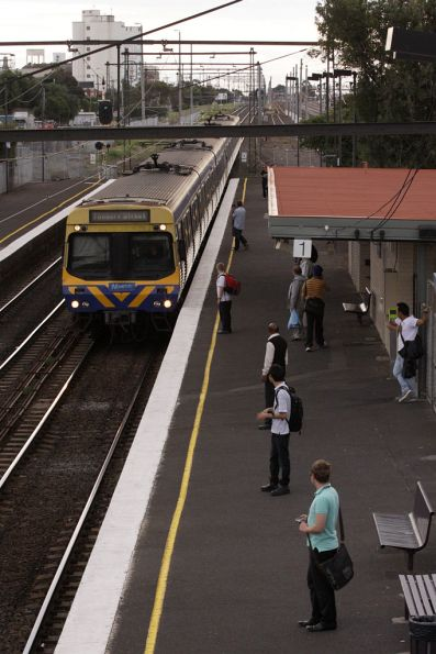 EDI Comeng on an up Sydenham service arrives into West Footscray