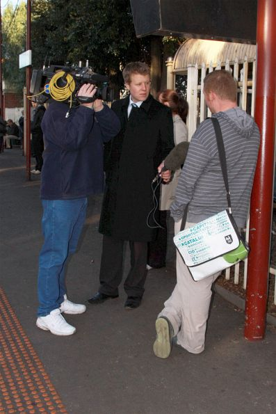 Channel 10 news interviewing a commuter at Newport station